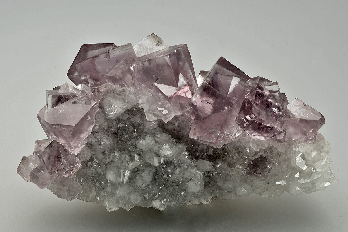 Fluorite on quartz, 340 level, Cambokeels mine, Eastgate, Weardale. 90x50x30